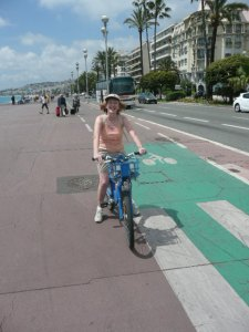 Julia on her bike on the Promenade des Anglais